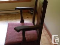 Sale is a sturdy Antique Oak Arm chair (dining or