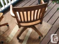 This impressive solid oak chair is in original