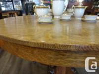 Antique quarter sawn oak round pedestal table with two