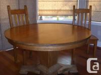 Canadiana antique pedestal table and four chairs. The