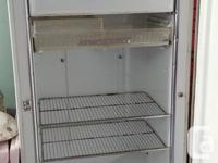 This old fridge could be used as a prop or made into a