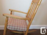 Antique wooden rocking chair made in Quebec.