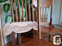 Round table with four chairs. Chairs restored and