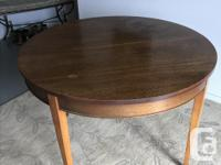 Antique solid oak round dining table with original