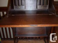 Antique walnut secretary desk,outside large drawer.