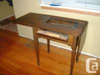 Antique sewing table in good condition. Was used as an