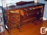 I am selling my unique antique buffet and sideboard -
