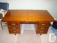 "Over-sized 72"" x 38"" solid oak desk with keyed locking"