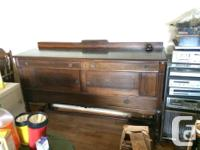 Solid Walnut table, chairs and sideboard. This antique