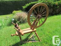 Beautiful antique wooden spinning wheel for sale. Seems