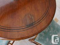 Inlaid antique table and 4 chairs. Table has water