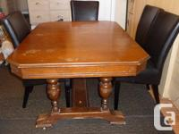 antique table with two original chairs and two buffets;