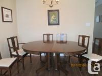 Antique quarter cut oak dining room table, split