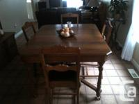 I have an Antique Table with 6 chairs one is a Captains