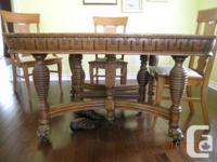 Unique table for sale. 50 X 50 quartered oak with lion