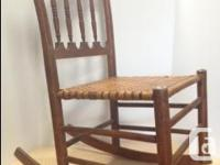 This is a beautiful small antique rocking chair in
