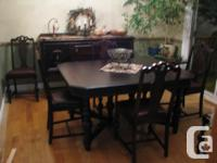 table with 2 leaves, arm chair and 5 chairs,