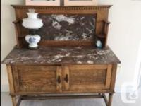A lovely antique washstand with marble backing and top