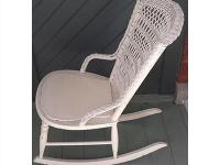 Antique white rattan rocking chair. This charming open