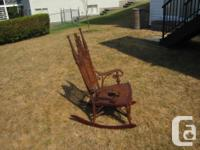 Rocking chair very decoratively made with wicker.