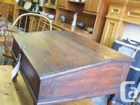 We have a very unusual find in this antique solid oak