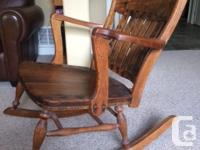 antique rocking chair i refinshed the wood but never
