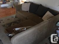 Right-facing, light brown sectional couch. Can be taken