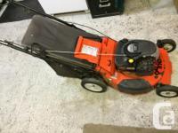 Ariens 6HP self propelled rear bagging lawnmower. Over
