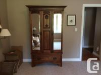 Beautiful, chestnut coloured Armoire for clothing or