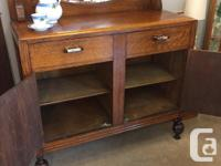 Lovely smaller oak sideboard with a mirrored back and