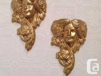 Stunning set of gold tinted terra-cotta wall surface