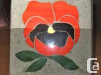 Handmade by a Kingston artist. Paint on a cement block.