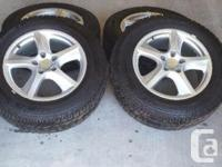 Selling nearly new winter tires with alloy rims (no