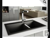 Brand new in box beautiful black granite double sink.