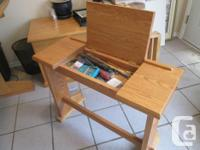 This one of a kind solid oak drawing/drafting table was