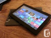 Like new in box Asus T100 Convertible Laptop/Tablet.