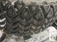 Set of 4 350 Mag Off Road ATV tires taking up room and