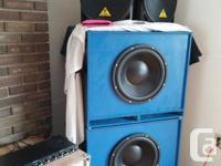 2 bass reflex subwoofers each packed with a 15 inch