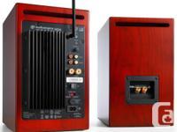 A pair of cherry Audioengine HD6 powered loudspeakers