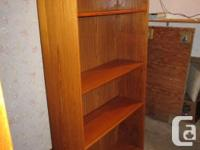 THIS TEAK BOOKSHELF IS 35 INCHES WIDE, 12 INCHES DEEP