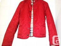 Beautiful Burberry red jacket in a vibrant red.