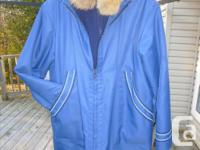 In mint condition, this handmade Inuit parka with outer