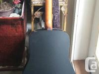 11 year old Art & Lutherie solid cedar top guitar. Hand