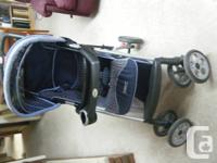 """In good condition one """"Safety 1st"""" folding baby buggy."""