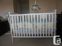 Selling rarely used crib with mattress, winnie the pooh