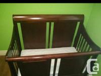 Solid wood crib. Converts into a double bed, after