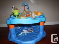 baby evenflo exersaucer           $30 baby rocker chair