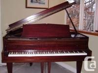 Beautiful walnut finished baby grand piano 4ft. 10 in