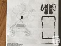Baby Jogger universal car seat adapter used for a city