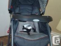 Stroller by baby trend oof condition orange and gray